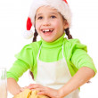 Smiling little girl kneading for Christmas cooking — Stock Photo #7620401