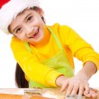 Smiling little girl kneading for Christmas cooking — Stock Photo #7621557