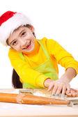クリスマス料理の混練笑顔の女の子 — ストック写真
