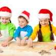 Three smiling kids with Christmas cooking — Stock Photo #7744975