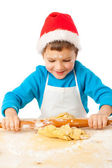 Smiling little bot kneading for Christmas cooking — Stock Photo