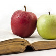 Apples and book — Stock Photo