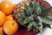 Pineaple and oranges — Stock Photo