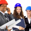A man and woman architect team on construction site — Stock Photo #7277858