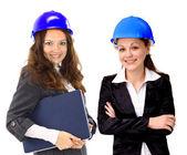 En attraktiv olika kvinna arkitekt team på byggarbetsplats — Stockfoto