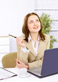 Casual business woman in office working with white table, laptop and diary — Stock Photo