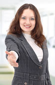 Lovely woman with an open hand ready for handshake — Stock Photo