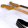 Stock Photo: Musical notes and guitar.