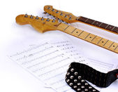 Musical notes and guitar. — Stock Photo