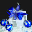 Festive balls with gift box on snow — Lizenzfreies Foto