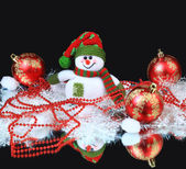Festive snowman with Christmas light background — Stockfoto