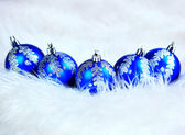 Blue christmas balls isolated on a white — ストック写真