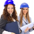 Royalty-Free Stock Photo: An attractive diverse woman architect team on construction site