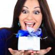 Stock Photo: Young happy woman with a gift