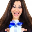 Young happy woman with a gift — Stock Photo #7943455