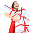Young happy woman with a gift — Stock Photo