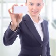 Beautiful businesswoman with the business card in the office — Stock Photo #7944089
