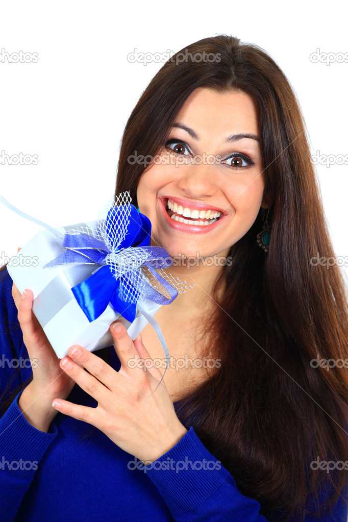 Young happy woman with a gift  Stock Photo #7943471