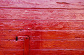 Painted doors red background — Stock Photo