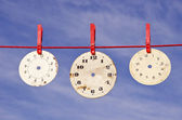 Clocks dials on red string — Stock Photo