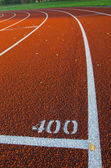 Evening light on autumn stadium track — Stock Photo