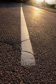 Sunrise light on asphalt road — Stock Photo