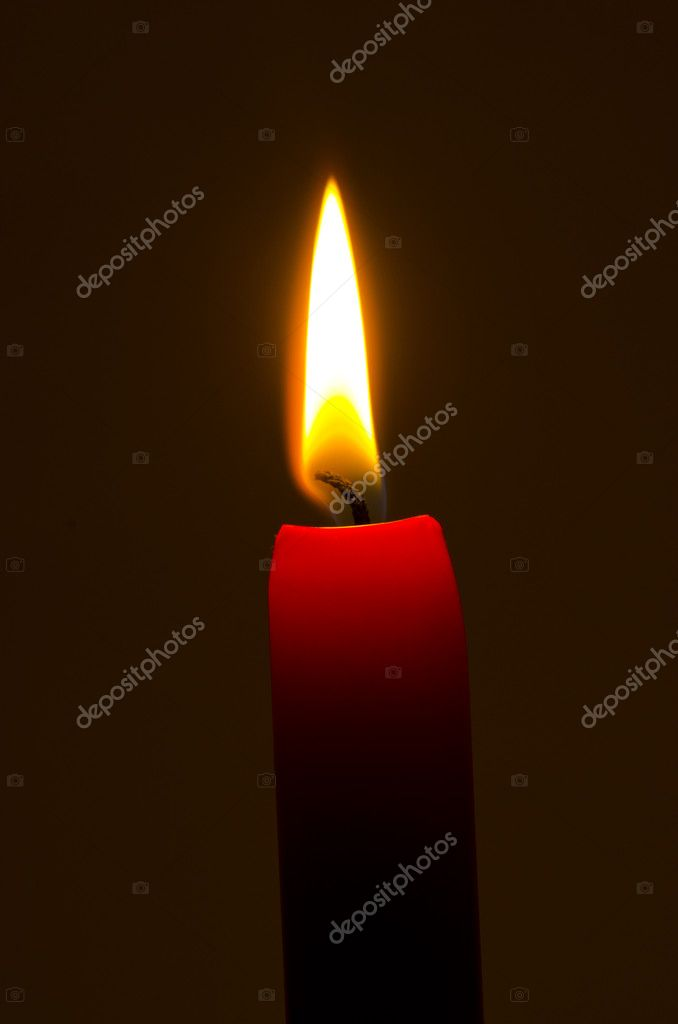Red candle flame and dark background — Stock Photo #7381532