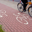 Bicycle track and bicycle wheels in motion - Lizenzfreies Foto