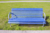 Blue seat on the grass — Stock Photo