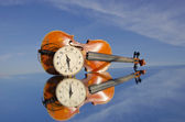 Old violin and clock-face — Stock Photo
