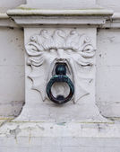 Urban architecture fragment with lion — Stock Photo