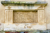 Historical ornamental wall background — Stock Photo