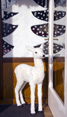 Christmas hind in the cafe door — Stock Photo