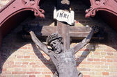 Historical crucifix fragment on wall — Stock Photo