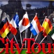 Stock Photo: City tour bus for tourists detail with flags