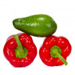 Isolated green avocado and two peppers — Stock Photo