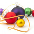 Christmas ball and yellow ribbon - Stock Photo