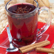 Glass of mulled wine with spoon and cinnamon - Stock Photo