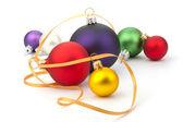 Christmas ball and yellow ribbon — Stockfoto