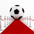 Soccer ball on the red carpet — Stock Photo
