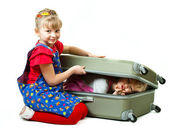 Little sisters and a suitcase — Stock Photo