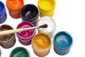 Colorful gouache paint and brush — Stock Photo