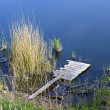 Wooden platform on the river — Stock Photo