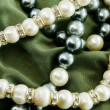 Pearls on green cloth — Stock Photo #7472583