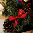 A fir tree with bow and cones — Stockfoto
