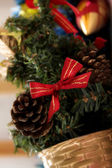 A fir tree with bow and cones — Stock Photo