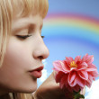 Profile of beautiful girl with flower — Stock Photo