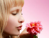 Beautiful girl with flower on pink background — Stock Photo