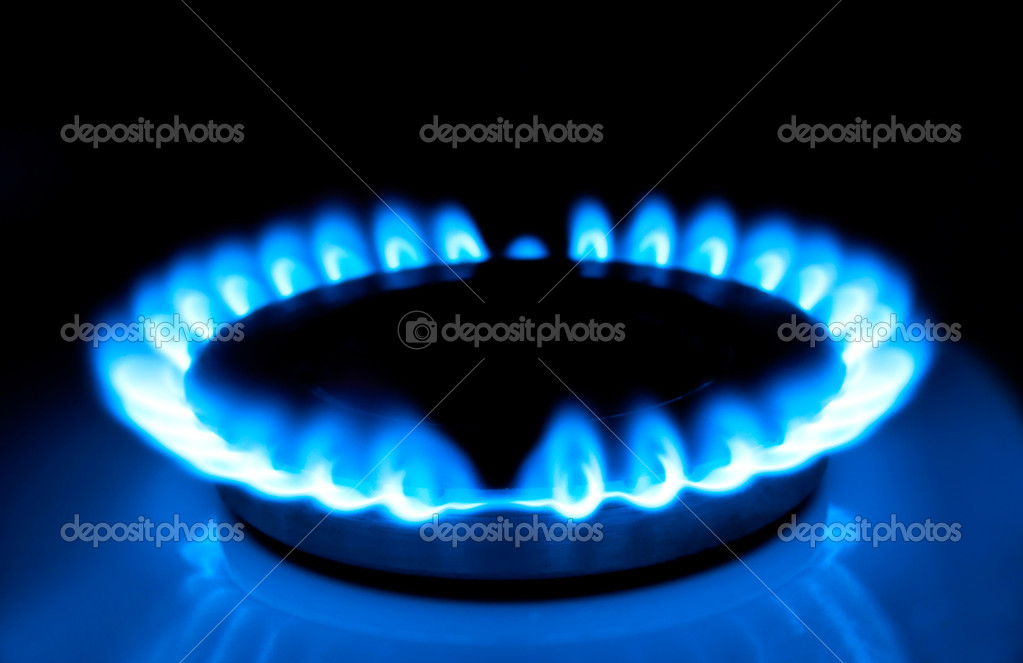 Natural gas in the home, a blue flame.  Stock Photo #7330088