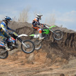 Two motocross riders on a motorbike jumps — Stock Photo